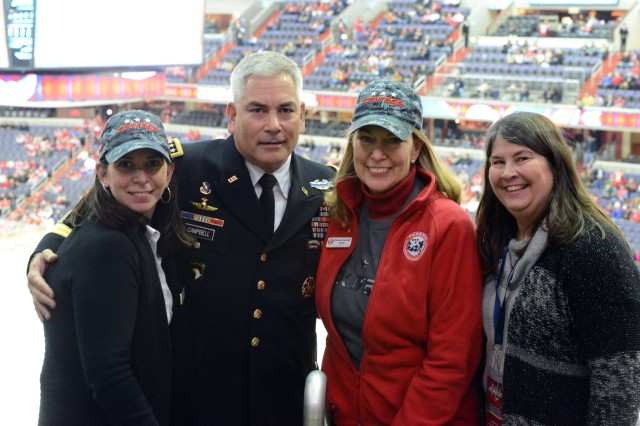 Army Vice Chief of Staff Gen. John F. Campbell poses for a photo with (from left): Bonnie Carroll, president and founder of Tragedy Assistance Program for Survivors; Diana Hosford, senior advisor, Strategic Partnerships, TAPS; and Ann, Campbell's wife.