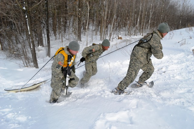 Soldiers compete in a sled pull event during the Mountain Winter Challenge that took place Jan. 28-30, 2014, at Fort Drum, N.Y.