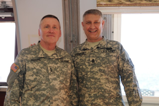 Sgt. Maj. of the Army Raymond F. Chandler III poses with Maj. Gen. Lawrence A. Haskins, commander of the California National Guard, while at Seaside Galley, where their separate visits crossed paths during their respective visits to Joint Task Force Guantanamo Bay, at U.S. Naval Station Guantanamo Bay, Cuba, Feb. 5, 2014. Chandler's visit was to inspect the JTF GTMO quality of life, with the intent of improving it for deployed service members.  (Editor's note: For operational security reasons, some people pictured are not identified, or may be using an alias, to include a modified nametape on their uniforms.)