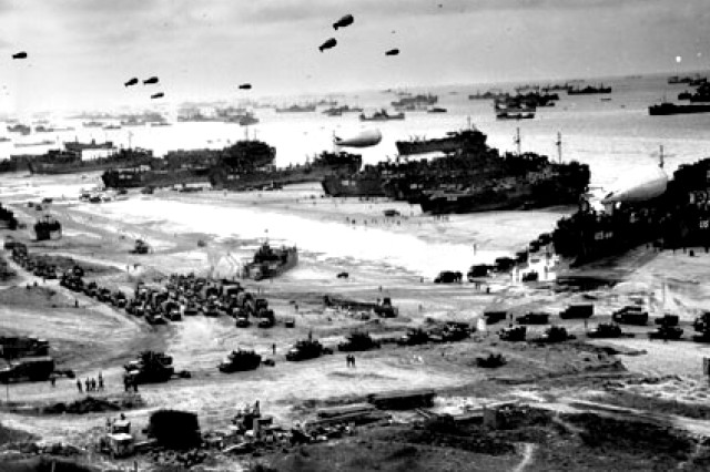 "The barrage balloons depicted in this D-Day invasion photo were a vital part of protecting Allied forces from strafing German aircraft. The balloons were manned by Soldiers of the all-black 320th Very Low Altitude (VLA) barrage balloon battalion. Steel cables hung down from the balloons, and one of them actually cut the wing off a Junkers Ju-88 aircraft over Omaha Beach, giving the battalion a confirmed ""kill"" on D-Day."