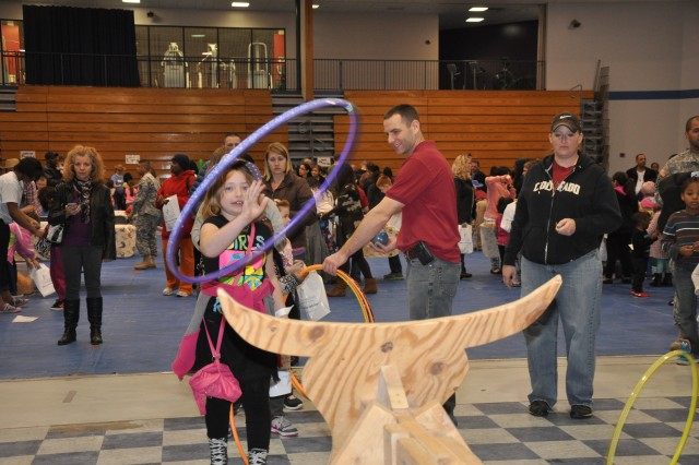 Mackenzy Fox, 8, tries to lasso a steer with a hula hoop during last week's family event.