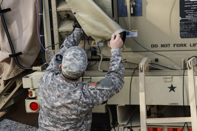 "FORT CAMPBELL, Ky. - Pfc. Nicholas Giancola, a Nodal Network Systems Operator/ Maintainer assigned to Company C, 3rd Special Troops Battalion, 3rd Brigade Combat Team ""Rakkasans,"" 101st Airborne Division (Air Assault), works to maintain the Capability Set 2013 communications system on a vehicle during a Field Training Exercise here Friday. The FTX was part of a new systems fielding test to train on the Army's new CS-13 program. (Photo by Sgt. Brian Smith-Dutton 3rd BCT Public Affairs)"