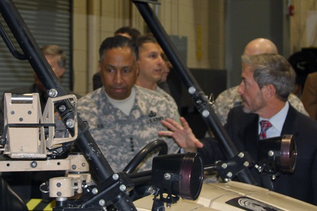 During a November visit to the Aviation and Missile Research Development and Engineering Center, AMC commander Gen. Dennis Via tours the AMRDEC Prototype Integration Facility with Danny Featherston, PIF Program Manager.