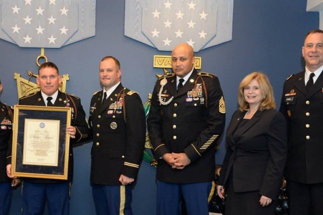 Members of Company D, 3rd General Support Aviation Battalion, 82nd Combat Aviation Brigade accept the Secretary of Defense Award for Maintenance Excellence, Field-Level, Medium Category during a ceremony at the Pentagon, Feb. 5. The award recognizes outstanding performance in Army field-level and depot-level maintenance. Presenting the award are Kathleen S. Miller, Assistant Deputy Chief of Staff G-4 at US Army, second from right, and Maj. Gen. Kevin O'Connell, Forces Command Deputy Chief of Staff, G-4, far right. Accepting the award, from left, are Co. D, 3-82 GSAB Command Team Capt. Kimberly Shelton and Sgt. 1st Class John Bloyd, and 3-82 GSAB Command Team, Lt. Col. William Braman and Command Sgt. Maj. Norris Wrenn. The unit went on to win the Phoenix award, which recognizes the �'best of the best�' in Army maintenance excellence.