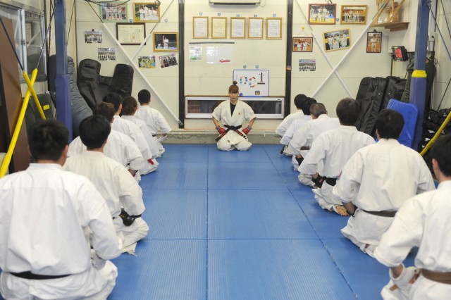Risa Sudo, center, a master labor contract employee assigned to the 403rd Army Field Support Battalion-Northeast Asia at Sagami General Depot, concludes a karate practice session at the Sagamihara Suzuki martial arts dojo by offering a traditional bow of respect to both her students and the dojo.