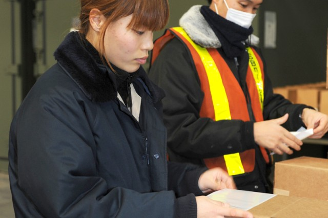 Risa Sudo, left, a master labor contract employee assigned to the 403rd Army Field Support Battalion-Northeast Asia at Sagami General Depot, categorizes parts for military vehicles with a member of her team.