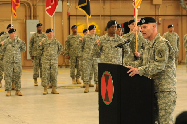 Maj. Gen. Stephen R. Lanza, 7th Infantry Division's outgoing commander, introduces the 7th ID incoming commander, Maj. Gen. Terry Ferrell, at the division's change of command ceremony, Feb. 4, 2014.  Lanza will take over command of I Corps at the end of the week. (Photo by U.S. Army Staff Sgt. Dayan Neely, 20th Public Affairs Detachment)