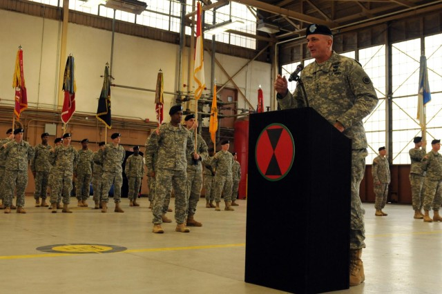 Lt. Gen. Robert B. Brown, JBLM's I Corps commander, introduces the outgoing 7th Infantry Division commander, Maj. Gen. Stephen R.  Lanza, at the division's change of command ceremony, Feb. 4, 2014.  Lanza will take over command of I Corps at the end of the week.  (Photo by U.S. Army Staff Sgt. Dayan Neely, 20th Public Affairs Detachment)