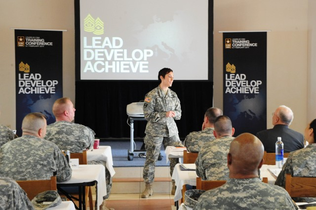GRAFENWOEHR, Germany -- Master Sgt. Jennifer Loredo, Comprehensive Soldier and Family Fitness Program, speaks to the participants of the 2014 U.S. Army Europe Command Sergeant Major Conference, being held at the 7th Army Noncommissioned Officer Academy, here, Feb. 6, 2014.