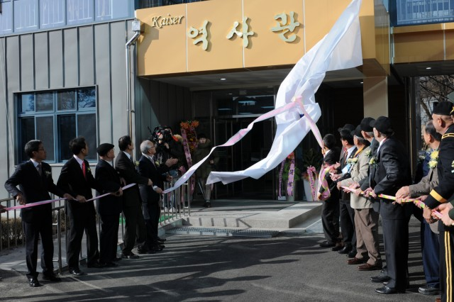 Korean War veterans, military leaders and school officials unveil the new Kaiser Hall Museum at Gapyeong High School in South Korea, Feb. 7, 2014.