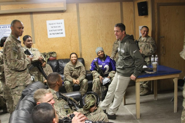 Baltimore Ravens head coach John Harbaugh talks to Soldiers of the Maryland National Guard's 1229th Transportation Company at Kandahar Airfield's Morale, Welfare and Recreation Game Room, in Afghanistan, Feb. 6, 2014. Harbaugh was in southern Afghanistan with Gen. Ray Odierno, chief of staff of the Army, to visit deployed service members and thank them for their service.