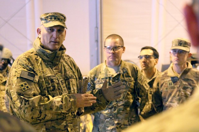 Gen. Raymond T. Odierno, 38th chief of staff of the Army, addresses Soldiers of 1st Infantry Division's 1st Combat Aviation Brigade, at Kandahar Airfield, Feb. 7, 2014. Odierno was in southern Afghanistan with Baltimore Ravens head coach John Harbaugh to meet with deployed service members.