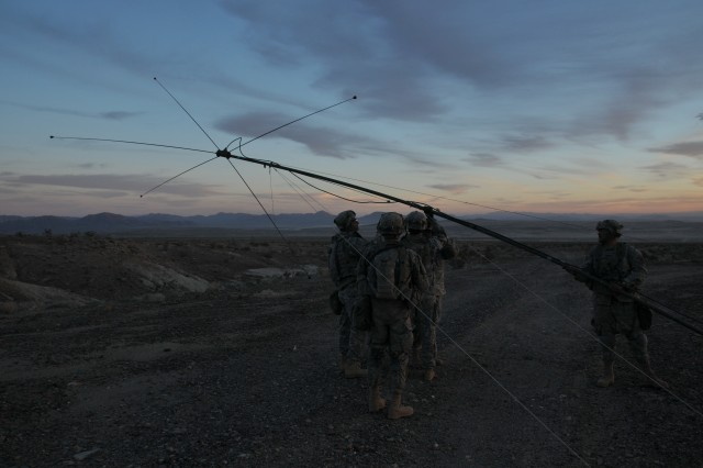 Soldiers of Delta Company,1st Battalion, 3d U.S. Infantry Regiment (The Old Guard), raise an antenna, Jan. 27, at the National Training Center [NTC] on Fort Irwin, Calif. The antenna is used for multiple communications across the battlefield. (U.S. Army photo by Spc. Klinton Smith)