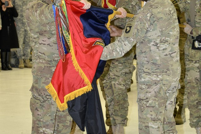 Maj. Gen. James C. McConville and Command Sgt. Maj. Alonzo J. Smith, Division commander and Division command sergeant major of the 101st Airborne Division (Air Assault), uncase the Division colors after a 12-month deployment to Afghanistan during a ceremony at Fort Campbell, Ky., Feb. 7. The Division's colors being uncased signifies the completion of the unit's overseas mission and their return to garrison operations.