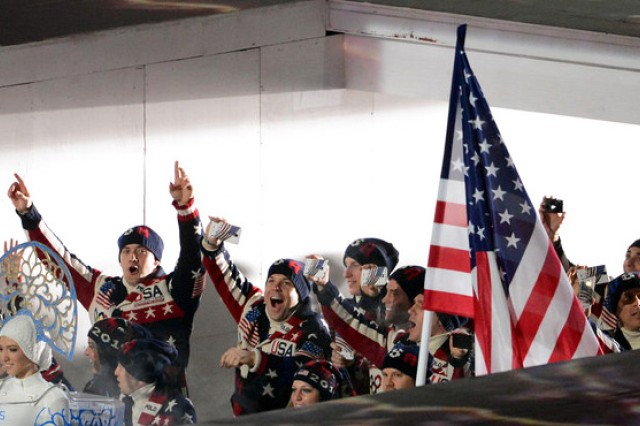 U.S. Army World Class Athlete Program and Olympic gold medalist bobsledder Sgt. Justin Olsen (arms upraised) of San Antonio helps lead Team USA into Fisht Olympic Stadium during the Opening Ceremony of the Sochi 2014 Olympic Winter Games, Feb. 7, 2014, at Olympic Park in Sochi, Russia.