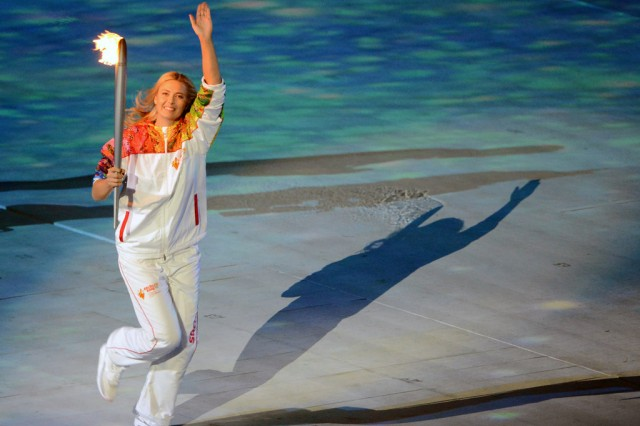 Russian tennis player Maria Sharapova, currently ranked No. 3 in the world by the Women's Tennis Association and holder of four Grand Slam singles titles, carries the Olympic torch Feb. 7, 2014, during Opening Ceremony for the Sochi 2014 Olympic Winter Games at Fisht Olympic Stadium in Sochi, Russia.
