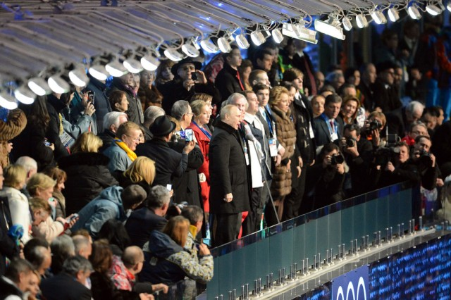 President of the Russian Federation Vladimir Putin (standing center in black coat) officially declares the Sochi 2014 Olympic Winter Games open, Feb. 7, 2014, during ceremonies at Fisht Olympic Stadium in Sochi, Russia.