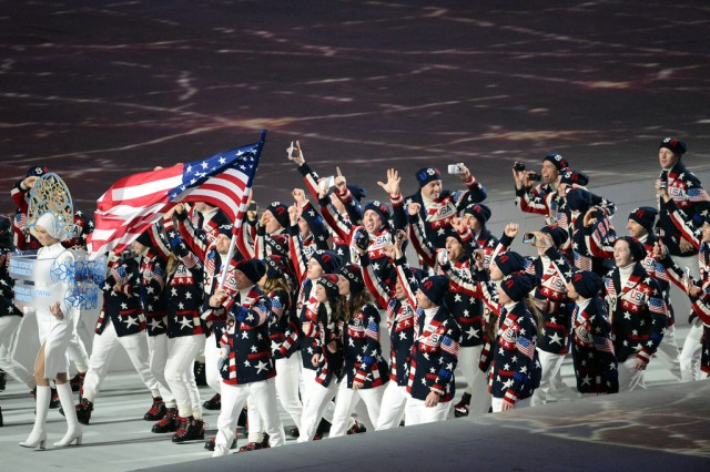 U.S. Army World Class Athlete Program bobsledder Sgt. Dallas Robinson of Georgetown, Ky. (center with arms upraised) and WCAP bobsled teammate Capt. Chris Fogt of Alpine, Utah (just to the right of Robinson with fists upraised) march into Fisht Olympic Stadium during the Opening Ceremony of the Sochi 2014 Olympic Winter Games, Feb. 7, 2014, at Olympic Park in Sochi, Russia.