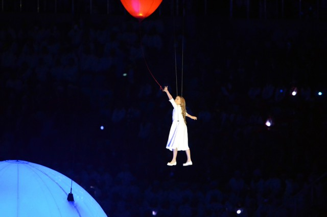 "Lubov, the ""hero girl"" who guides specators through the ""Dreams about Russia"" themed Opening Ceremony of the 2014 Olympic Winter Games, Feb. 7, 2014, at Fisht Olympic Stadium in Sochi, Russia, releases her red balloon and the dream of Russia's mid-20th century with great hope for the future during ""Moskva/The Dream"" segment of the show."
