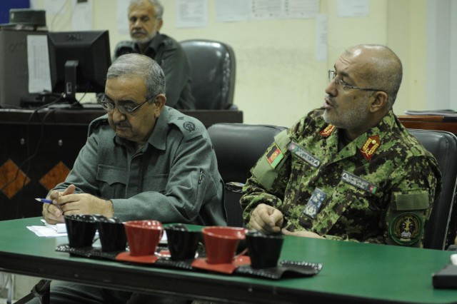 Afghan National Army Maj. Gen. Abdul Nasir Ziyai (right), and Afghan National Police Brig. Gen. Mir Jalaludin Jamshed (left), the director and deputy director, respectively, for the Operation Coordination Center-Regional at Forward Operating Base Gamberi, go through the morning reports for the region Feb. 4, 2014. The men help control and disseminate information about operations conducted between each of the pillars of the Afghan National Security Forces across seven provinces in eastern Afghanistan. (U.S. Army Photo by Spc. Eric Provost, Task Force Patriot PAO)