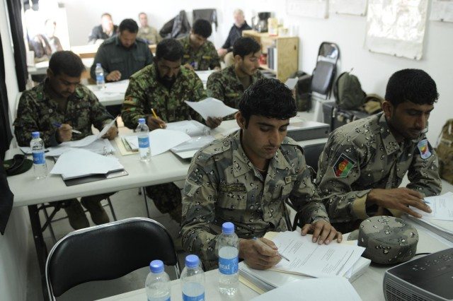 Afghan National Army soldiers and policemen recruited to work at various Operations Coordination Centers across Regional Command-East go through the four week foundations course Feb. 4, 2014, at the Regional OCC at Forward Operating Base Gamberi. The course teaches the recruits skills in operations, intelligence, computers, and other areas to prepare them for their mission at the OCC. (U.S. Army Photo by Spc. Eric Provost, Task Force Patriot PAO)