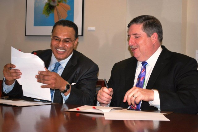 The U.S. Army Research Laboratory and the University of Maryland Baltimore County signed a research and education partnership agreement during a ceremony held at the university's administration building on Jan. 14. Dr. Thomas Russell, director of ARL (right) and Freeman A. Hrabowski, III, president of UMBC (left), formally signed the agreement.