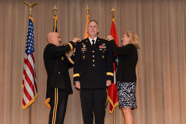 Brig. Gen. David P. Glaser has his new rank pinned on by Mag. Gen. David E. Quantock and Mrs. Glaser