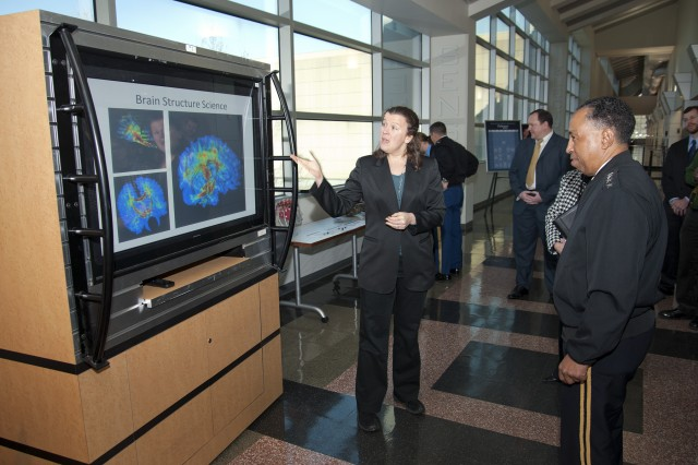 Dr. Jean Vettel briefs Gen. Dennis L. Via, Army Materiel Command commanding general, on U.S. Army Research Laboratory's research in the area of brain structure science, during Via's visit to the lab in Adelphi, Md., Feb. 7, 2014.