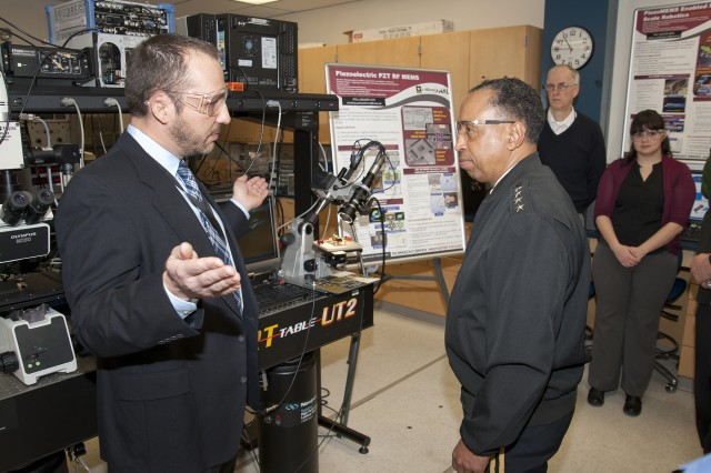 Dr. Gabriel Smith (left) briefs Gen. Dennis L. Via, the Army Materiel Command commanding general, on Piezoelectric lead zirconate titanate radio frequency microelectromechanical systems, or PZT RF MEMS, during the Feb. 7, 2014, tour of the laboratory in Adelphi, Md.