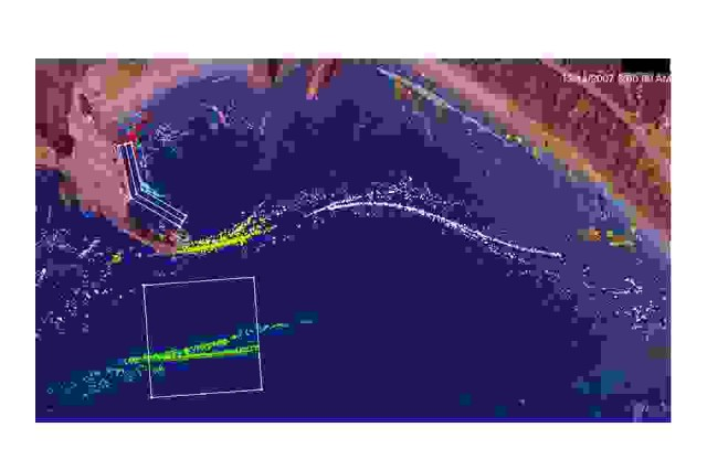 The photo depicts the pathways of sediment particles adjacent to the Port of Port Orford, Ore. Red lines indicate the sources of released particles.