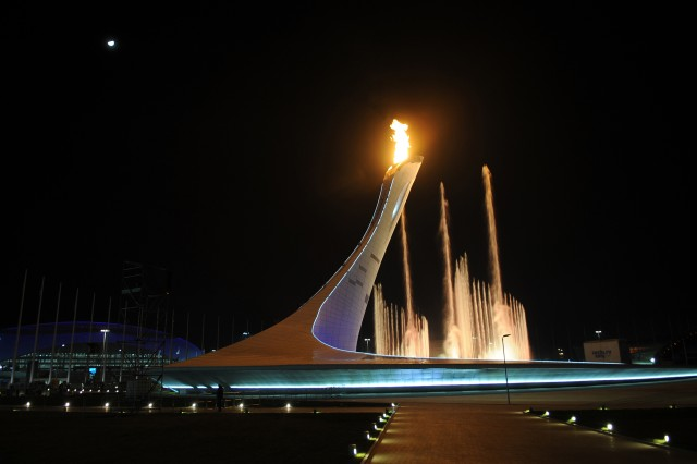 The Olympic flame burns above a dancing water fountain outside Fisht Olympic Stadium following the Open Ceremony for the 2014 Olympic Winter Games, Feb. 7, in Sochi, Russia.