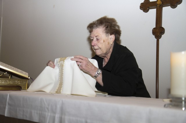Zella Shugart makes last minute adjustments to the altar table prior to service at the Spiritual Fitness Center at Fort Hood, Feb. 2. Shugart has provided support as a member of the altar guild in the Episcopal congregation for more than 40 years. (U.S. Army photo by Sgt. Angel Turner, 1st Cav. Div. PAO (Released)