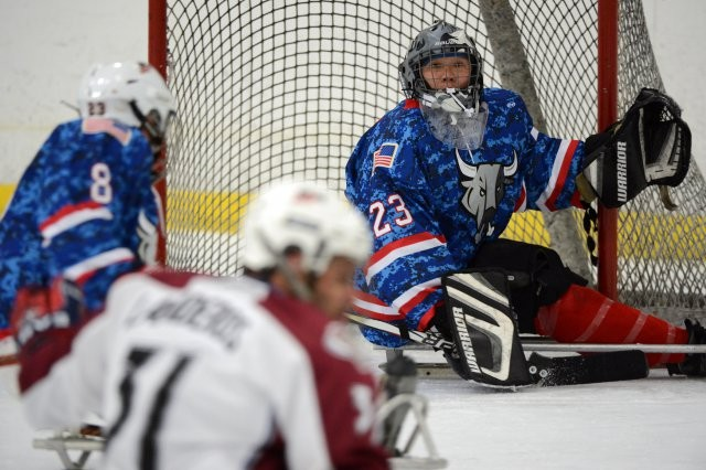 Now-World Class Athlete Program Sgt. Jen Lee defends the net for the San Antonio Rampage Sled Hockey Team in San Antonio, Aug. 1, 2013. Lee, Rico Roman and Joseph Sweeney have been selected to represent Team USA at the 2014 Paralympic Winter Games in Sochi, Russia, March 7-16, 2014.