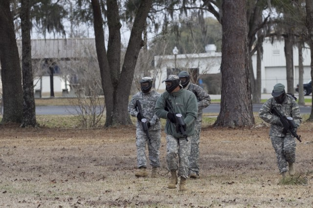 Soldiers assigned to A Company, 1/321st Infantry Regiment, 98th Training Division, 108th Training Command (IET), engage each other with paintball guns during the unit's battle assembly training on individual and squad movement techniques. The unit utilized paintball training in order to heighten the level of realism to the training at Charleston Air Force Base recreation area on February 8. Here, they practice a diamond formation.
