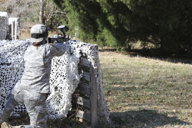 "Capt. Jessica Smothers, commander of A Company, 1/321st Infantry Regiment, 98th Training Division, 108th Training Commands (IET), engages the ""enemy"" with a paintball  gun during his unit's battle assembly training on individual and squad movement techniques. The unit utilized paintball training in order to bring a heightened sense of realism to the training on February 8 at the Charleston Air Force Base recreation area in Charleston, S.C."
