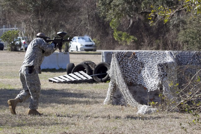 "Staff Sgt. Jerry Camacho, assigned to A Company, 1/321st Infantry Regiment, 98th Training Division, 108th Training Command (IET), advances and engages the ""enemy"" with a paintball gun during his unit's battle assembly training on individual and squad movement techniques. The unit utilized paintball training in order to heighten the level of realism to the training at Charleston Air Force Base recreation area on February 8."