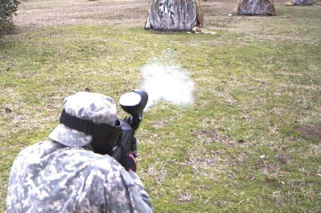 Sgt. Robert Stegall, assigned to A Company, 1/321st Infantry Regiment, 98th Training Division, 108th Training Command (IET), test-fires a paintball gun just prior to his unit's battle assembly training on individual and squad movement techniques. The unit utilized paintball training in order to heighten the level of realism to the training at Charleston Air Force Base recreation area on February 8.
