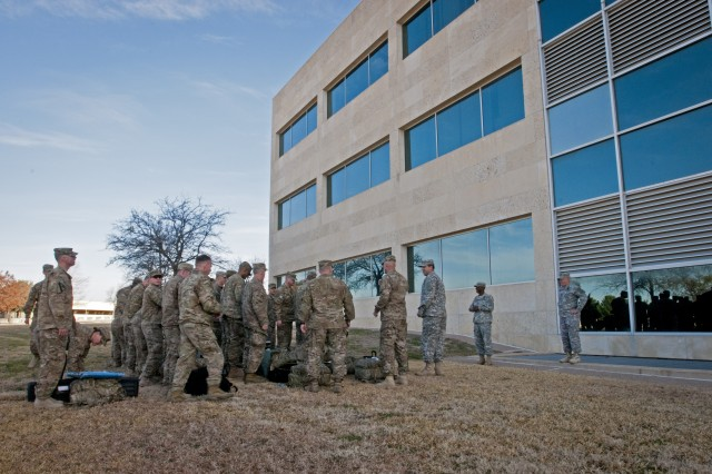 Soldiers with the Headquarters and Headquarters Company, III Corps, muster outside the III Corps Headquarters building on Fort Hood before marching in to their welcome home ceremony, Feb. 9, 2014. The HHC returned after completing a nine-month deployment in Afghanistan. (U.S. Army photo by Sgt. Ken Scar, 7th Mobile Public Affairs Detachment)