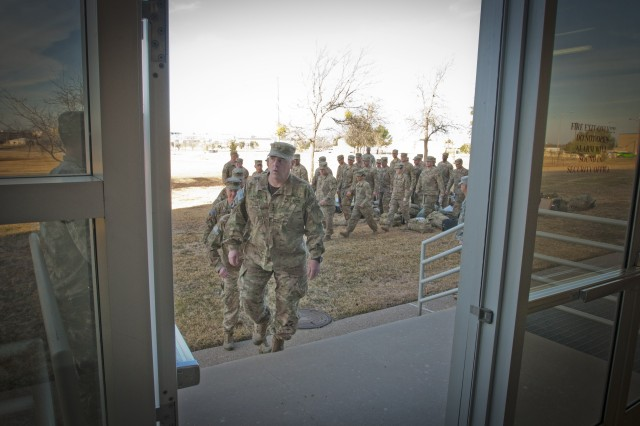 Lt. Gen. Mark Milley, III Corps and Fort Hood commanding general, leads Soldiers from Headquarters and Headquarters Company, III Corps, into the III Corps Headquarters building on Fort Hood for their welcome home ceremony after serving nine months in Afghanistan, Feb. 9, 2014. (U.S. Army photo by Sgt. Ken Scar, 7th Mobile Public Affairs Detachment)