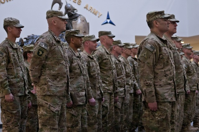 Members of the III Corps Headquarters Company wait patiently to be released by the III Corps and Fort Hood commanding general, Lt. Gen. Mark Milley, during their welcome home ceremony, Feb. 9, 2014. (U.S. Army photo by Sgt. Ken Scar, 7th Mobile Public Affairs Detachment)