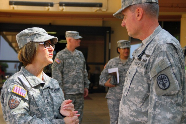 Army Surgeon General, Lt. Gen. Patricia Horoho speaks with Commanding General for Pacific Regional Medical Command and Tripler Army Medical Center (TAMC), Brig. Gen. Dennis Doyle after wrapping up the first day of her Asia-Pacific tour on February 10, 2014.