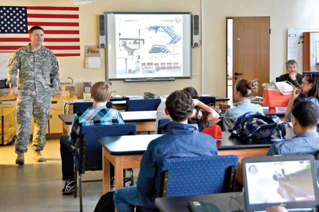 Maj. William McGlothlin, operations officer for U.S. Army Garrison Wiesbaden's Directorate of Public Works, shares tips for encouraging recycling and energy conservation with members of the Wiesbaden high School's Environmental Club.