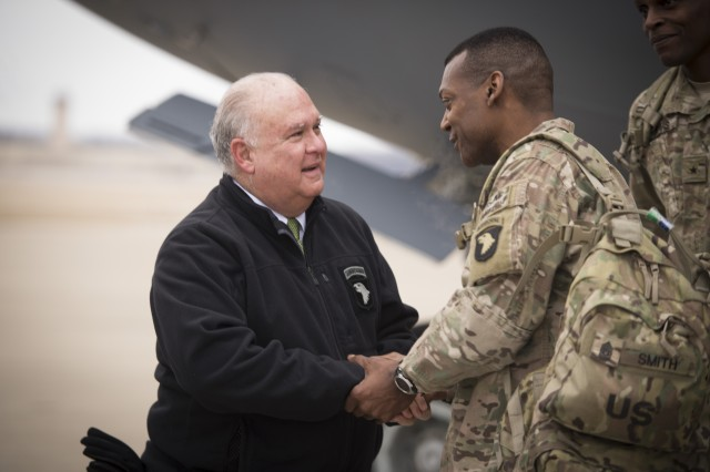 Under Secretary of the Army Joseph W. Westphal greets Command Sgt. Maj. Alonzo J. Smith, senior enlisted for the 101st Airborne Division (Air Assault), as the division command group arrives at Campbell Army Airfield, Feb. 7, 2014, after a year-long deployment in Regional Command-East at Bagram Airfield, Afghanistan. Westphal praised the division's accomplishments and recognized the important role they played in overseeing the transition of authority and responsibility for Afghanistan's security throughout Regional Command-East to the Afghan National Army.