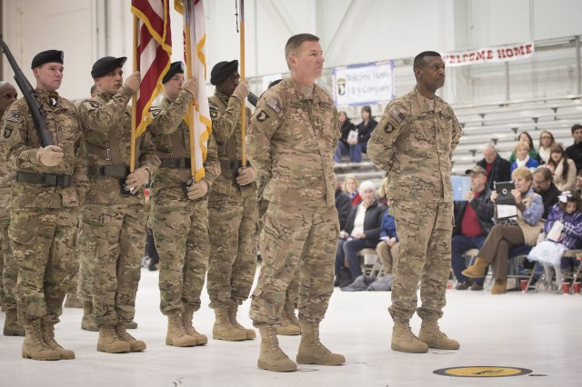 Maj. Gen. James C. McConville, commander of the 101st Airborne Division (Air Assault), and Command Sgt. Maj. Alonzo J. Smith and the division staff arrive at Campbell Army Airfield, Feb. 7, 2014,  after a year-long deployment in Regional Command-East at Bagram Airfield, Afghanistan.