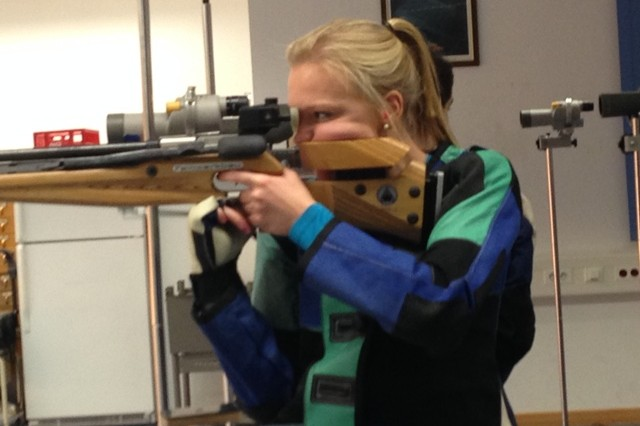 HMHS Tigers Rifle team captain Katherine Gamble takes aim during a DODDS Eastern Conference rifle match.