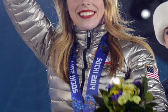 Army family member Ashley Wagner waves to the crowd at Victory Plaza after receiving an Olympic Bronze Medal for Team Figure Skating in Sochi, Russia, Feb. 10, 2014. This is the first Olympic Winter Games for Team Figure Skating as a medal sport.