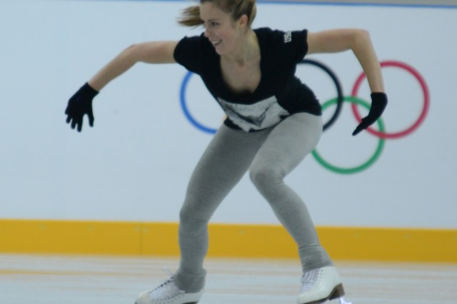 Army family member Ashley Wagner practices on the ice in Socci, Russia, Feb. 10, 2014, just hours before she and Team USA receive the first-ever Olympic bronze medal for Team Figure Skating.
