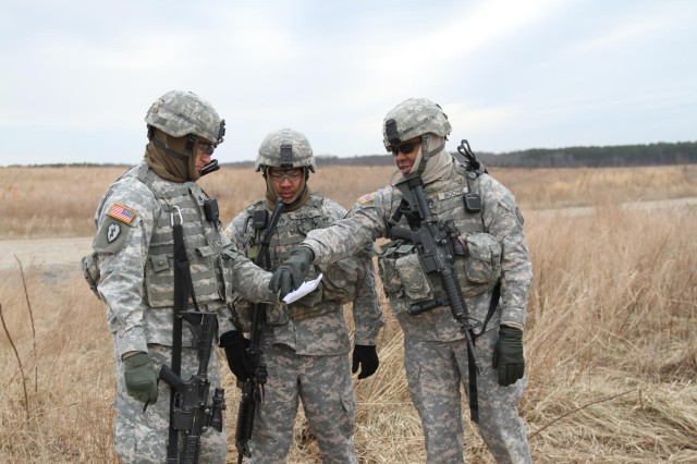 From left, Staff Sgt. Zachary Eierman, Staff Sgt. Nho Nguyen, and Staff Sgt. Rowle Boone, noncommissioned officers from 1st Platoon, 218th Military Police Company, 716th Military Police Battalion, 101st Sustainment Brigade, 101st Airborne Division (Air Assault), plan a rehearsal for detainee operations during an air assault training mission Jan. 27, at Fort Campbell, Ky. The unit trains hard to ensure everybody is proficient at their jobs in any situation. (U.S. Army photo by Sgt. Leejay Lockhart, 101st Sustainment Brigade Public Affairs)