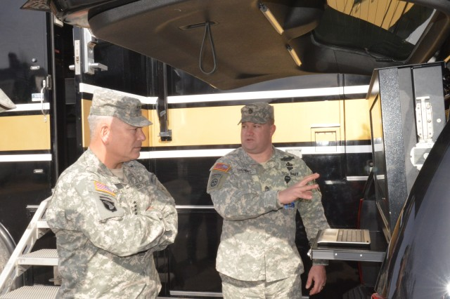 Master Sgt. Scott Thomas, U.S. Army Military District of Washington (MDW) operations, explains the capabilities of an Emergency Response Vehicle to Army Vice Chief of Staff, Gen. John F. Campbell during the general's visit at Fort Lesley J. McNair, Feb. 6, 2014. Campbell was provided an update on the mission and capabilities of the Joint Force Headquarters - National Capital Region and MDW.