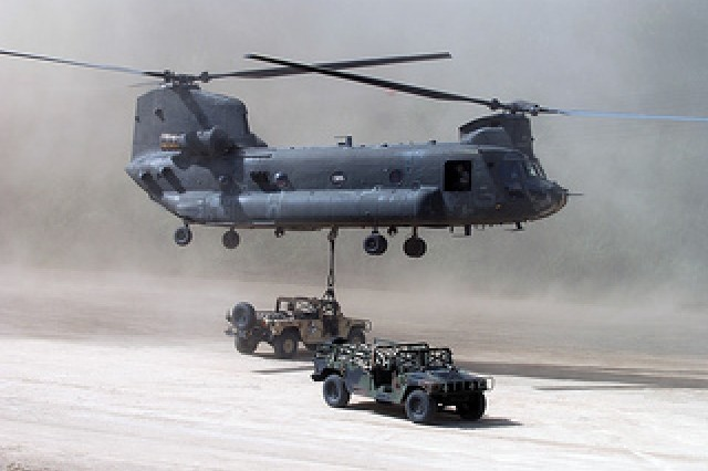 A CH-47 Chinook Helicopter is flown by pilots